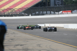 Cars leave the pitlane for practice