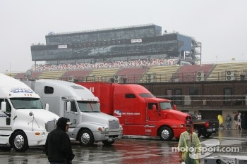 Transporters sit in the rain