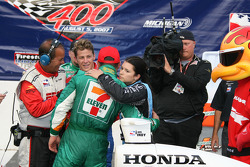 Winners circle: Tony Kanaan is congratulated by Danica Patrick