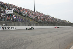 Race winner Tony Kanaan takes the chequered flag