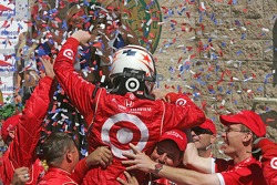 Victory lane: race winner Scott Dixon celebrates with Target Chip Ganassi Racing team members