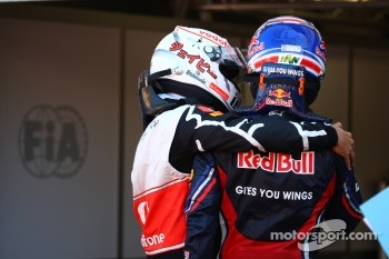 Jenson Button, McLaren Mercedes with Mark Webber, Red Bull Racing