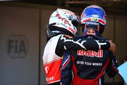 Jenson Button, McLaren Mercedes with Mark Webber, Red Bull Racing
