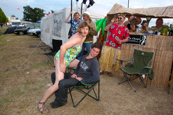 Fans entertain themselves in the campground