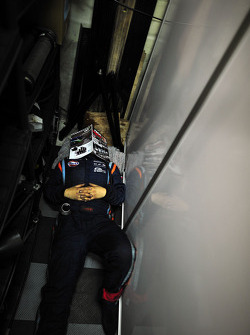 OAK Racing mechanics sleep in the early morning hours