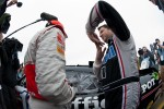 Tony Stewart explains the roof flaps to Lewis Hamilton