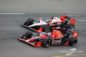 2011 Iowa winner Marco Andretti goes under Helio Castroneves