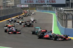 Lewis Hamilton, McLaren Mercedes leads a pack of cars