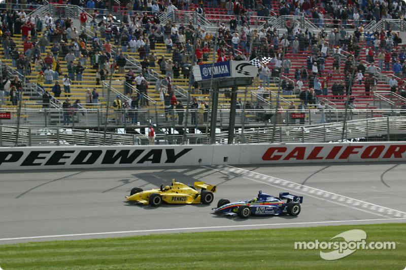 Sam Hornish Jr. taking the checkered flag in front of Jaques Lazier