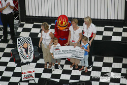 Pre-race ceremonies: Firehawk and CARA charities making a presentation to St. Thomas Hospital