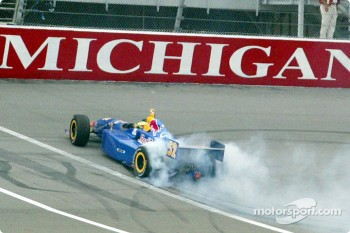 Tomas Scheckter smoking the tires