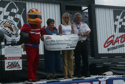CARA presenting a check to the Oliver Anderson Hospital