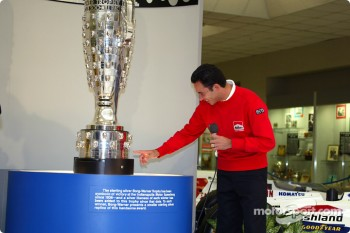 Helio Castroneves happy with his face on the trophy