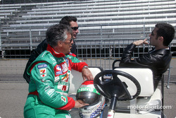 Mario Andretti talks with Max Papis and Dario Franchitti