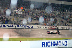 Scott Dixon takes a combination red flag and checkered flag for the victory in the rain