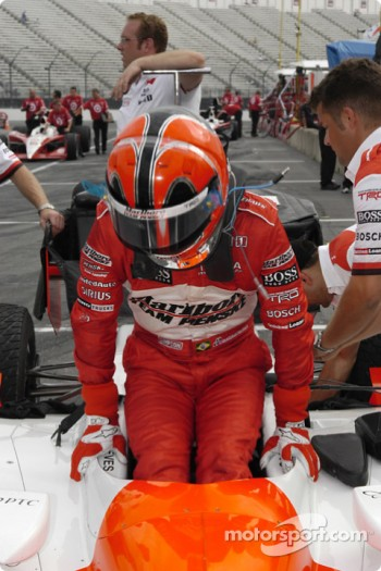 Helio Castroneves climbs from car