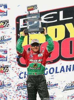 Victory lane: race winner Adrian Fernandez celebrates