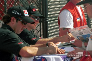 Christian Fittipaldi and Cristiano da Matta signing autographs