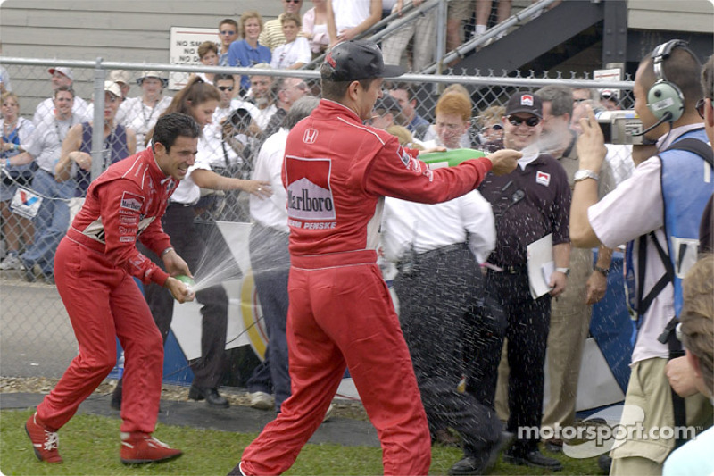 Helio Castroneves and Gil de Ferran: champagne for everyone