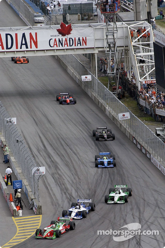 Early race action: Adrian Fernandez in front of Michael Andretti