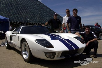 Visit to the Rock and Roll Hall of Fame: Mario Dominguez, Michel Jourdain Jr., Alex Tagliani and Patrick Carpentier posing with a Ford GT40