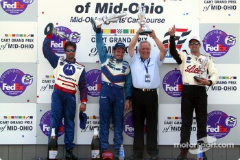 The podium: race winner Patrick Carpentier with team owner Gerry Forsythe, Michael Andretti and Christian Fittipaldi
