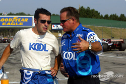 Dario Franchitti talking with George Klotz his chief mechanic before the race