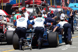 Forsythe Racing crew members push Paul Tracy's car out for the session