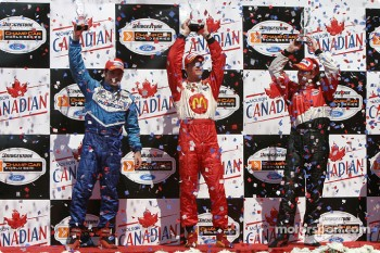 Podium: race winner Sébastien Bourdais with Jimmy Vasser and Patrick Carpentier