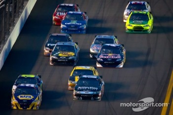 Martin Truex Jr., Michael Waltrip Racing Toyota leads the field
