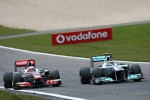 Jenson Button, McLaren Mercedes and Nico Rosberg, Mercedes GP F1 Team