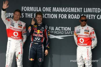 Jenson Button, McLaren Mercedes, Sebastian Vettel, Red Bull Racing and Lewis Hamilton, McLaren Mercedes