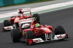 Felipe Massa, Scuderia Ferrari leads Fernando Alonso, Scuderia Ferrari