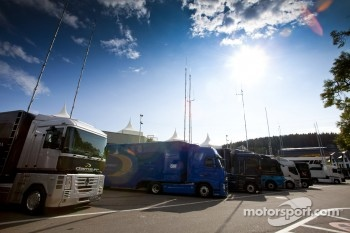 GP2 team trucks in the paddock