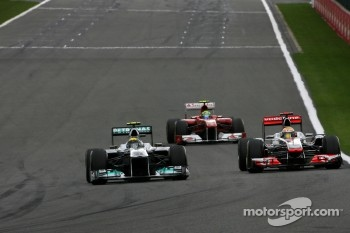 Nico Rosberg, Mercedes GP and Jenson Button, McLaren Mercedes