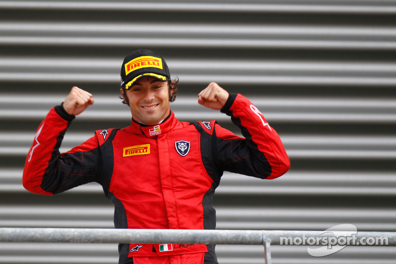 Luca Filippi celebrates his victory on the podium