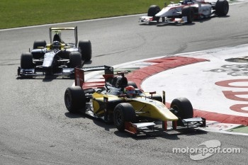 Romain Grosjean leads Adam Carroll