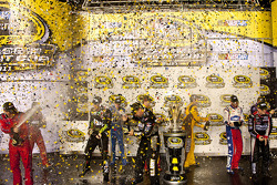 Chase for the NASCAR Sprint Cup 2011 drivers celebrate with champagne