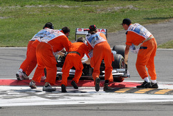 Rubens Barrichello, AT&T Williams gets beached on a curb after a crash caused by Vitantonio Liuzzi, HRT F1 Team