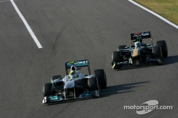 Nico Rosberg, Mercedes GP and Heikki Kovalainen, Team Lotus