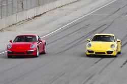 Romain Dumas and Jörg Bergmeister show off the new Porsche 911