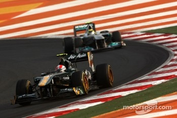 Jarno Trulli, Team Lotus leads Nico Rosberg, Mercedes GP Petronas F1 Team