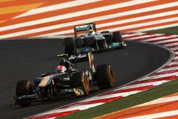 Jarno Trulli, Team Lotus leads Nico Rosberg, Mercedes GP Petronas F1 Team