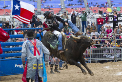 Kyle Petty rides a bull for .8 seconds