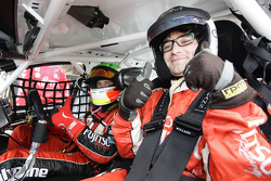 Beauty and the Geek star Jimmy goes for a hot lap in a V8 Supercar with driver Michael Caruso during the Falken Tasmania Challenge