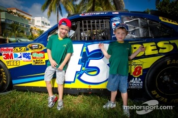 NASCAR Championship Drive in South Beach: young fans pose with the car of A.J. Allmendinger, Richard Petty Motorsports Ford