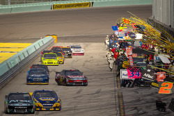 Carl Edwards, Roush Fenway Racing Ford and Martin Truex Jr., Michael Waltrip Racing Toyota lead the field on pit road