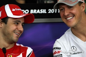 Felipe Massa, Scuderia Ferrari and Michael Schumacher, Mercedes GP
