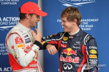 Jenson Button, McLaren Mercedes with Sebastian Vettel, Red Bull Racing gets pole position and the most pole positions in one season