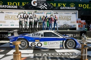 Victory lane: DP class and overal winners A.J. Allmendinger, Oswaldo Negri, John Pew and Justin Wilson, GT class winners Andy Lally, Richard Lietz, John Potter, Rene Rast